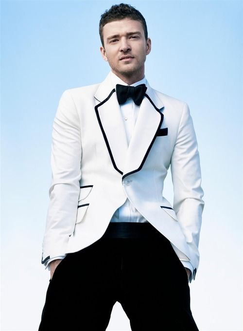 Justin Timberlake in white tuxedo jacket with black contrast trim and black bow tie and black pants ...perfection!