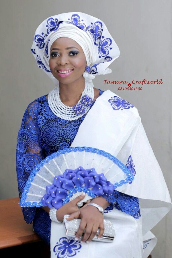 How we so much love our brides. Congrats Dr. Morenike Sunday-Adesina. A proverbs 31 woman you are. Yoruba wedding! Bead and Hand-fan by Tamara Craftworld.