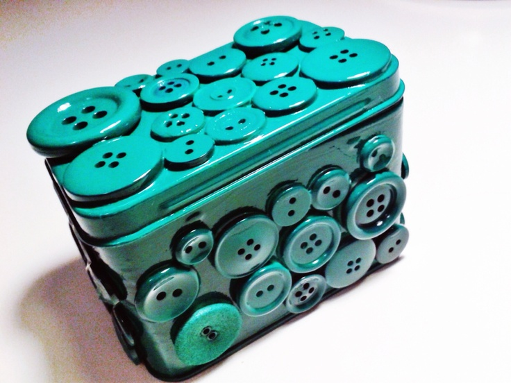 Metal box/can + glue gun + buttons + spray paint