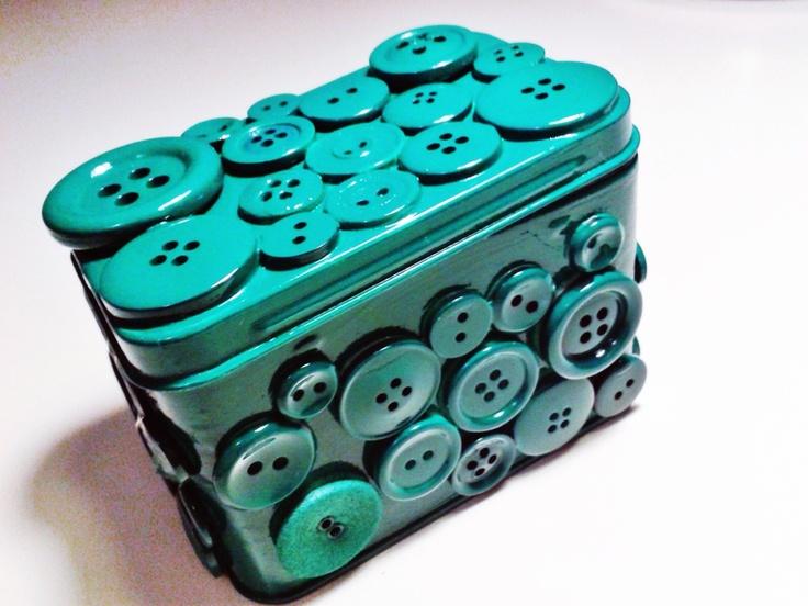Metal box/can + glue gun + buttons + spray paint