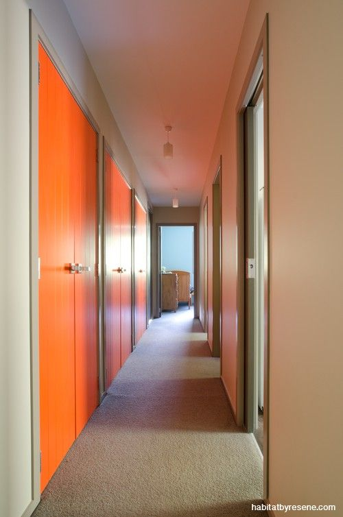 What a great way to brighten up a hallway – paint the doors in a cheerful orange, Resene Mexican Wave. The walls are painted in Resene Linen in a house designed by architectural designer Brynn McCauley. See the full story at http://www.habitatbyresene.co.nz/brynn-reveals-colour-within
