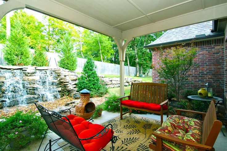 Traditional Porch with Pond, Wrap around porch, Glenbrook Black Patio Glider, Raised beds, exterior stone floors, Fence