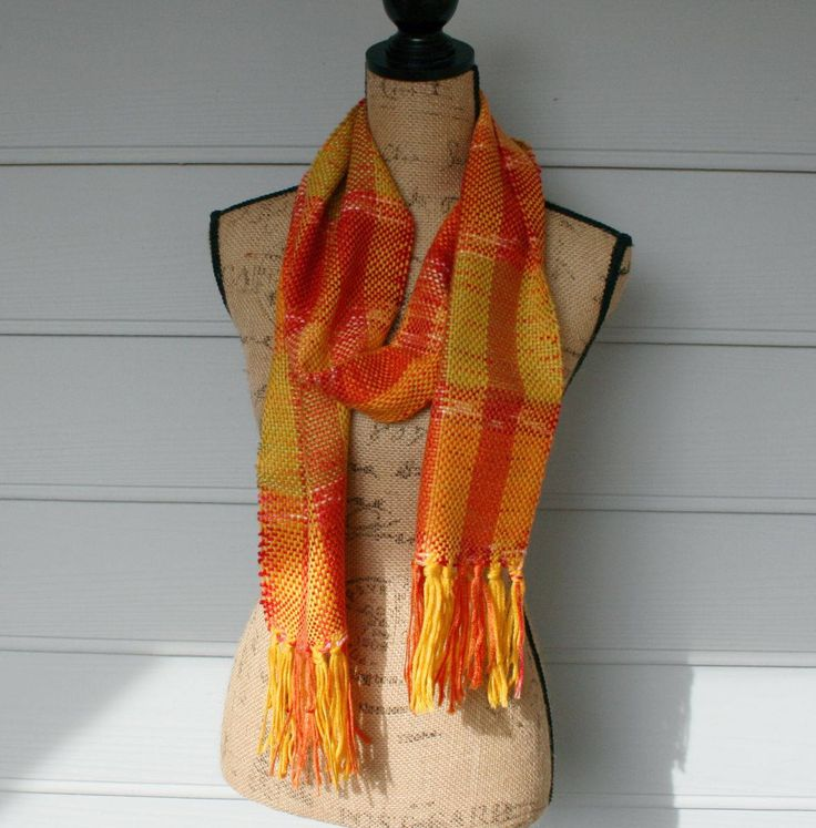 Wear the colors of fall.  This hand woven scarf is the definition of fall colors.  Oranges reds Greens and Yellows by TrinksKnitting on Etsy