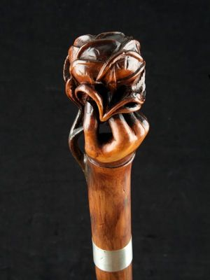 """""""A Rose in the Hand"""" handle walking cane ref: 12805   English  date circa: 1870 a large scale beautifully carved """" Rose in the Hand"""" handle walking cane, with slim silver collar on brown hardwood shaft ~ price upon application"""
