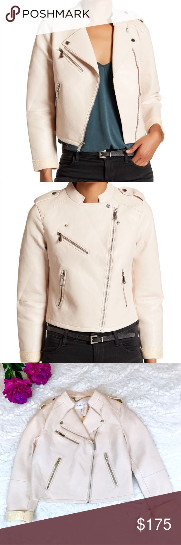"""BCBGeneration Blush Asymmetrical Zip Moto Jacket BCBGeneration Blush Asymmetrical Zip Moto Jacket. New with tags! Faux Leather with Silver Zipper and Button Detailing and Lace Detailing on the cuffs. Rugged distressed Seams for an effortlessly cool look.  Length: 21"""" Bust: 18"""" Flat Across Arm Length: 21"""" BCBGeneration Jackets & Coats"""