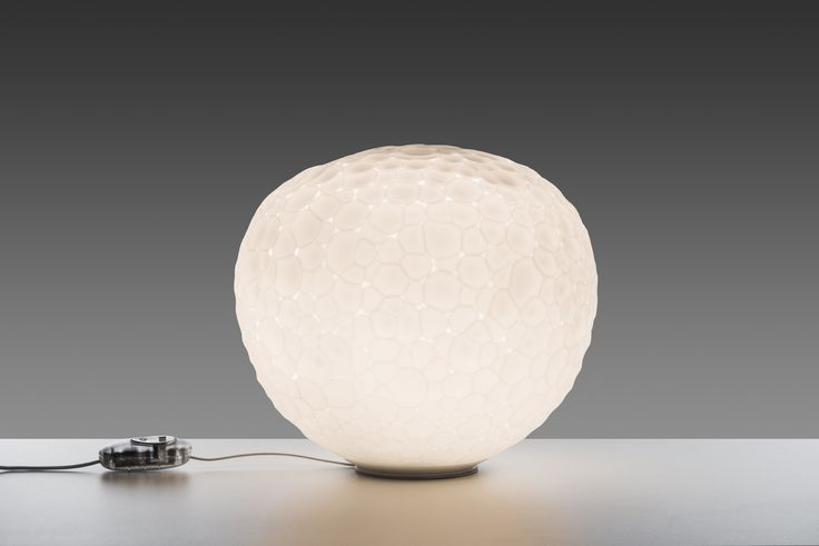 #Meteorite table lamp, #design Pio & Tito Toso. The diffuser is made of a double layer of artistic glass, obtained through a 'stampo a fermo' mould-blowing technique and then grinding.