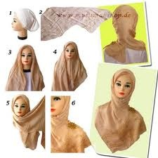 Using a simple square hijab which means the length and the widths of the hijab are equal. Place the hijab on a flat surface and fold it across a corner meaning lift one corner and drag it across to the diagonally opposite corner of the hijab. Lift the hijab which is in triangular shape by holding the two ends across and place it over your head bringing both ends to the sides of your face. Tie a knot at the bottom or use a hijab pin to attach the two ends together.