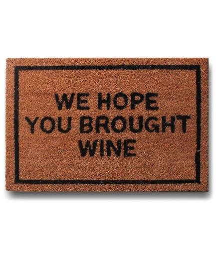 We Hope You Brought Wine Doormat | If you add this to your cart, you probably won't be bringing wine this time around. But think of this comical doormat as an extra generous gift to the best hostess you know. With this on her front step, all future guests will know exactly what's expected of them. If anything, it's an instant conversation starter.