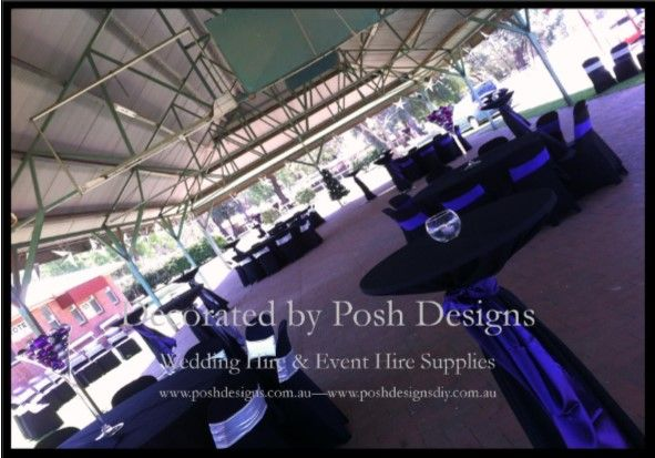 Purple satin sashes, black tablecloths, tall martini vases with purple and silver baubles, high bar tables, tea light candles all for hire. Australia wide. Visit www.poshdesigns.com.au for more photos and info, or email lisa@poshdesigns.com.au for pricing packages