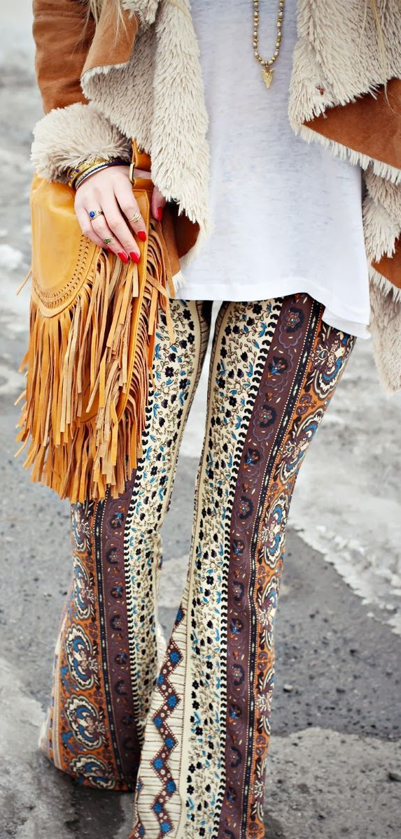 Boho chic ethnic tribal Print Flared palazzo Pants with modern hippie leather fringe purse. For the BEST Bohemian fashion trends   FOLLOW >>> http://www.pinterest.com/happygolicky/the-best-boho-chic-fashion-bohemian-jewelry-gypsy-/ <<< now.