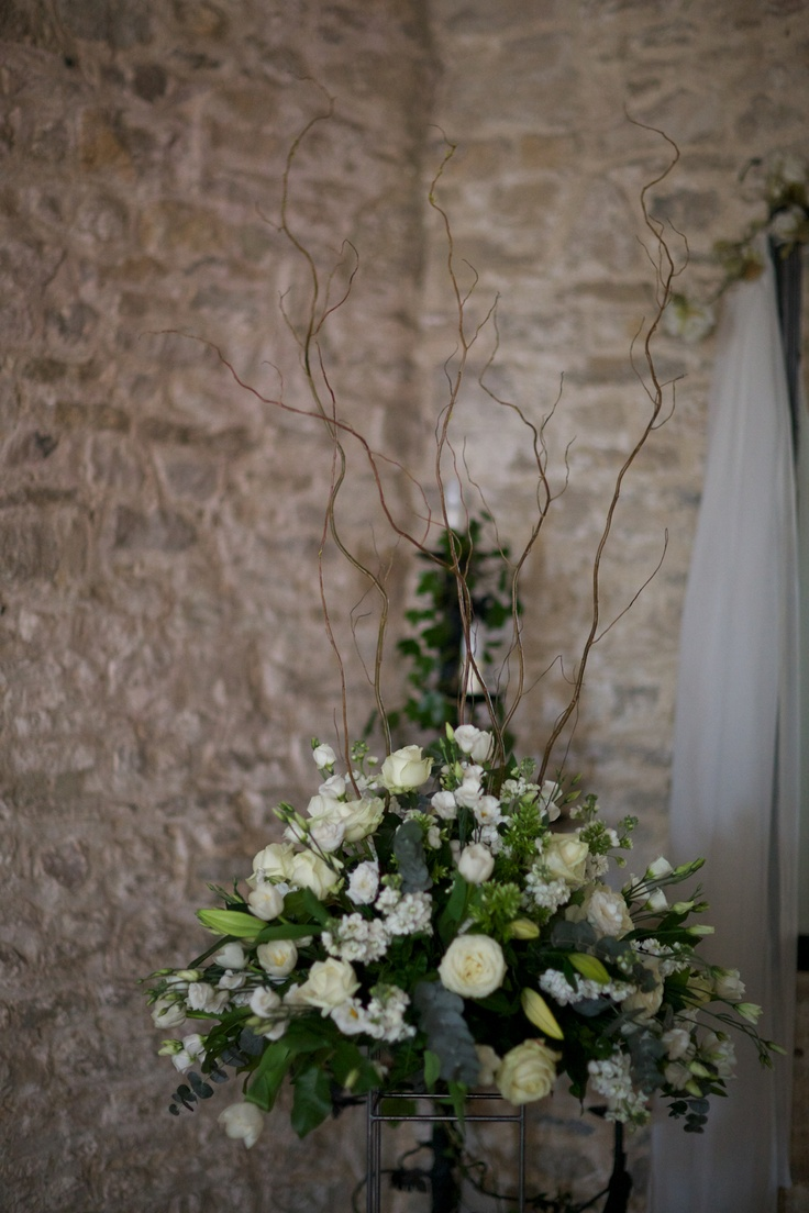 Our flowers were all cream. I then asked to have twisty sticks in the arrangements which suited our natural rustic theme.   Our fantastic photographer -http://www.davidmcneil.co.uk/