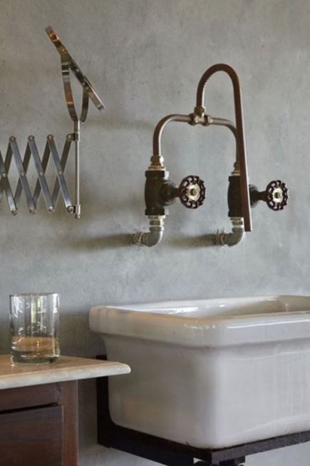 Wall-mounted faucet made from copper piping and industrial water shut-off valves by WHBC Architects