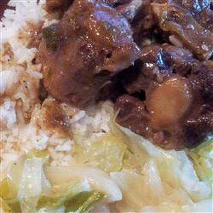 Oxtails with Gravy Recipe Main Dishes with oxtails, garlic, onions, salt, pepper, greek seasoning, seasoning salt, bacon drippings, all-purpose flour, broth, sauce, pepper, salt, garlic powder