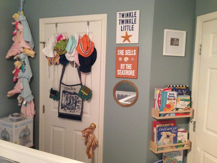 Wall decor is my take on rustic wooden signs I found online, just painted canvas with stenciled on lettering and hot glued starfish/shells. Round Mirror was $10 on Amazon, and I hot glued nautical rope around the edge. Bookshelfs are the ever popular IKEA spice racks