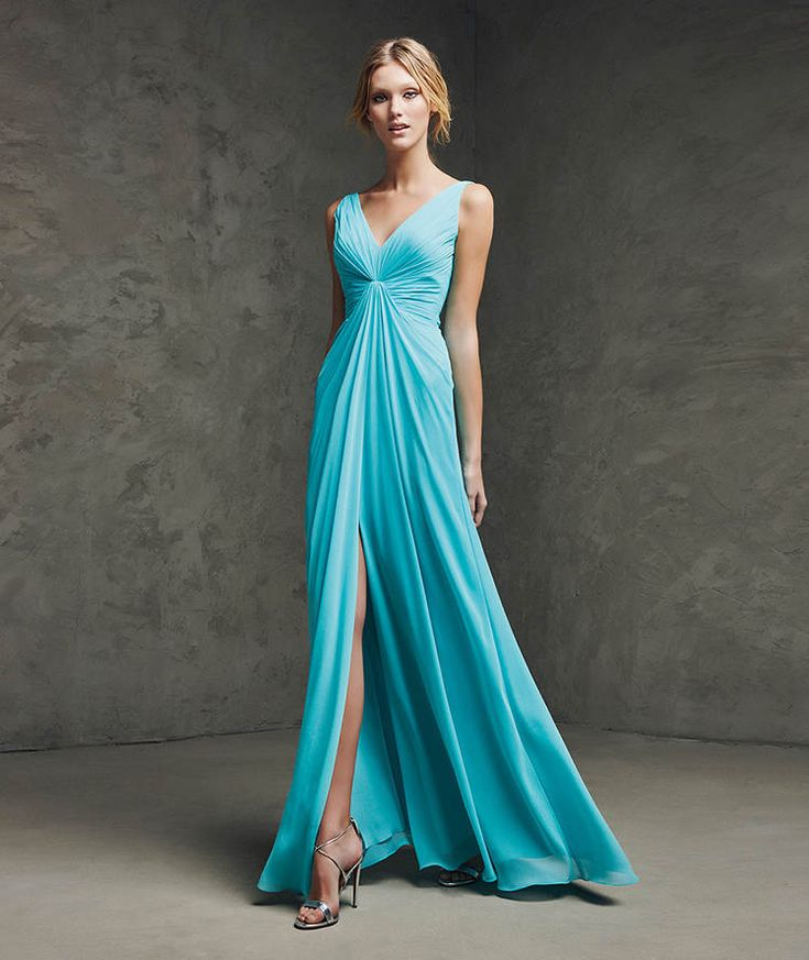 LAUNA- Long, elegant cocktail dress. Gauze cocktail dress with straps and V neckline. Draped bodice and skirt with front opening.