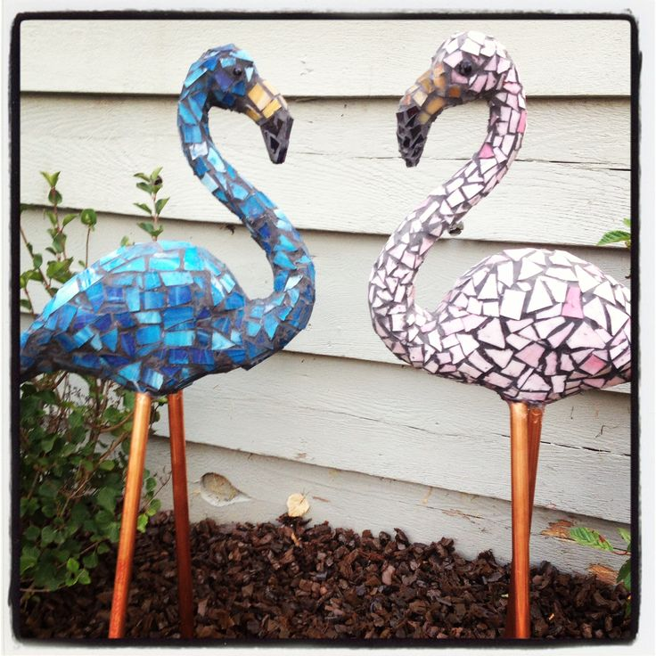 Glass mosaic flamingos.  Flamingos in love. Beautiful in my flower garden.