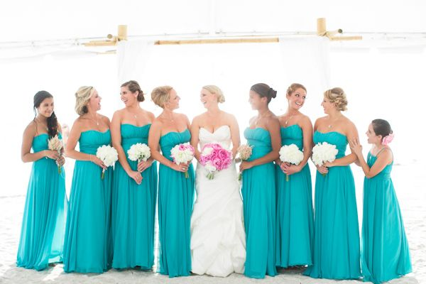 turquoise bridesmaid dresses.. i like these dresses and love the color..almost makes me want to switch and make the girls wear turquoise dresses and the guys wear purple tuxs.