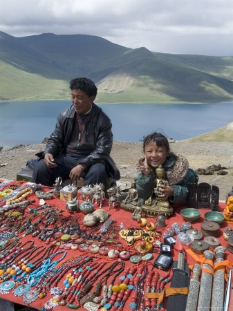 Craft vendor, Yamdrok Tso (Turquoise) Lake, Tibet. The holy Yamdrok Yumtso Lake lies to the south of Yarlong Tsangpo River in the Shannan Region of Tibet. It is one of three holy lakes in Tibet.