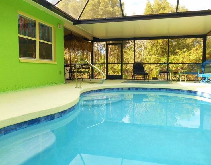 Saltwater pool with caged lanai is just one great feature of this 3 BR concrete block home with steel roof. No deed restrictions on your 1.25 fenced acres, surrounded by mature oak trees. Natural,...