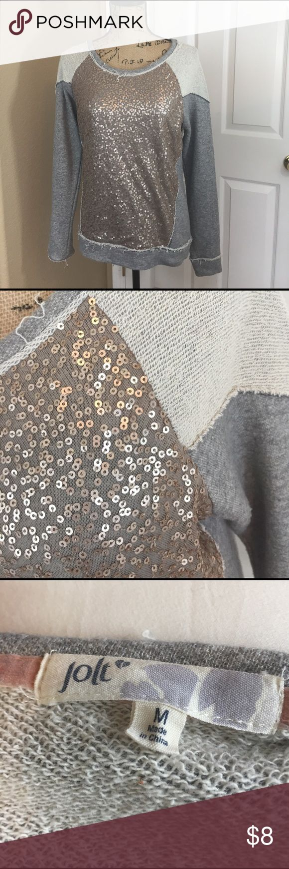 Gold sequence gray sweater Great sweater for relaxing in. It's a medium but for juniors. It's fits more like a small. Jolt Sweaters
