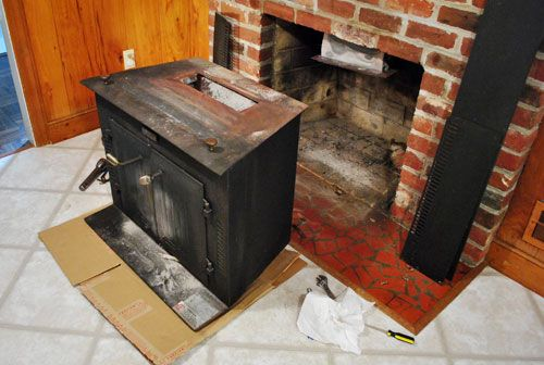 The beginning of a fireplace makeover removing a - How to put out a fireplace ...