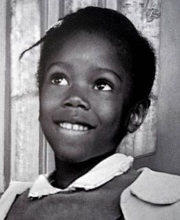 """Born September 8, 1954 Ruby Bridges was the first African American child to attend an all white elementary school in New Orleans. There was a large crowd outside of the school throwing, yelling, and protesting the integration. Ruby kept on walking, she shed no tear, and showed her courage.""  <3"