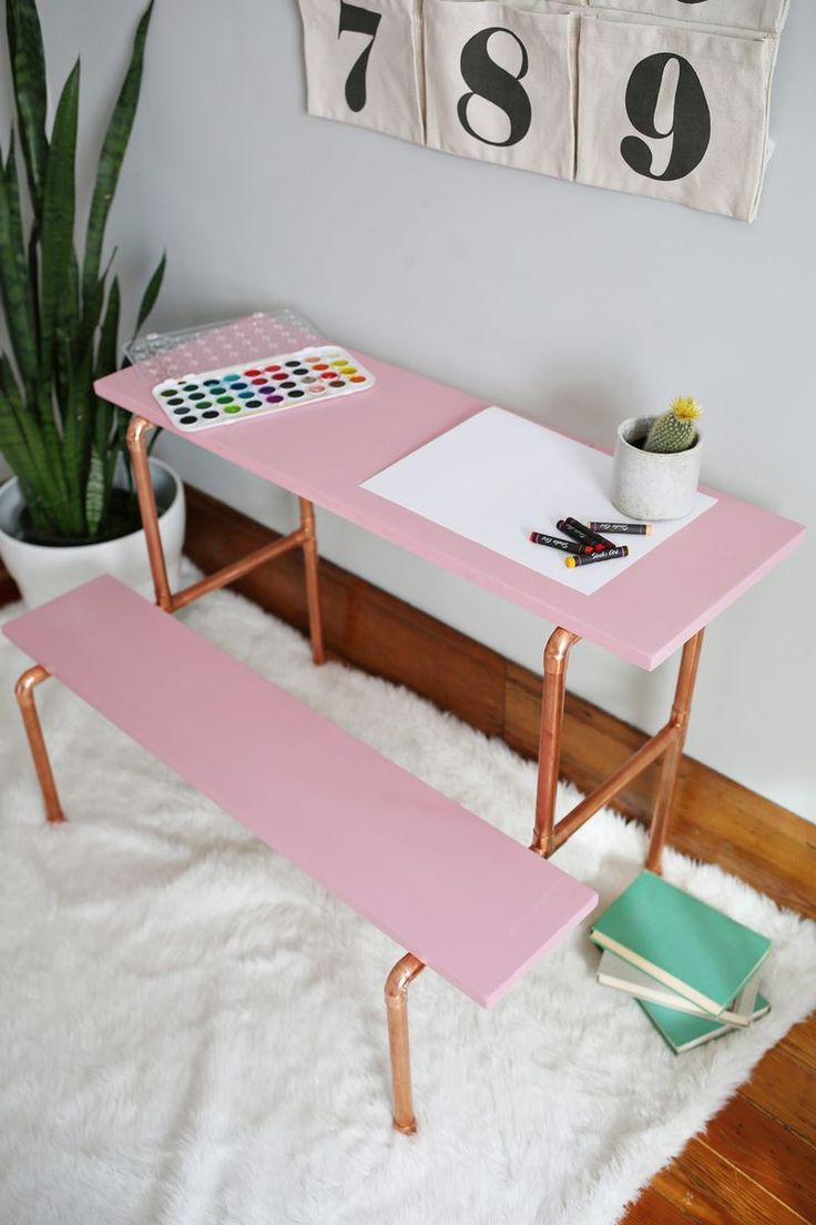 Long live the copper pipe and all its many uses! I designed this child-sized copper pipe desk after being inspired by a vintage set of stairs that were probably taken out of an elementary school's mus