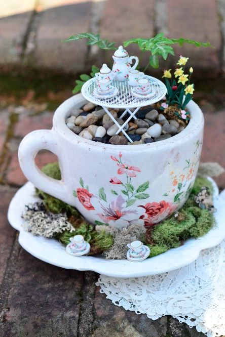 DIY Fairy Garden: A large teacup and saucer filled with styrofoam, covered with…