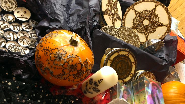 Henna at Halloween with hennaed tambourines, candles and pumpkins.