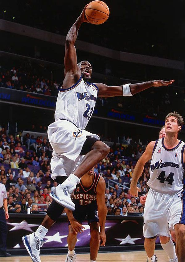 Washington Wizards #23 Michael Jordan goes up for a dunk vs. New Jersey Nets, 10/20/01, Washington, D.C.. Credit:Bob Rosato Preseason: New Jersey Nets @ Washington Wizards Nets @ Wizards- 2nd half MCI Center/Washington, DC 10/20/01 Credit: Bob Rosato SetNumber: X64154 TK2 R6 F22