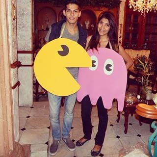 For an easy DIY duo costume, take poster board, markers and ribbon to create these Pacman and Ghost costumes!