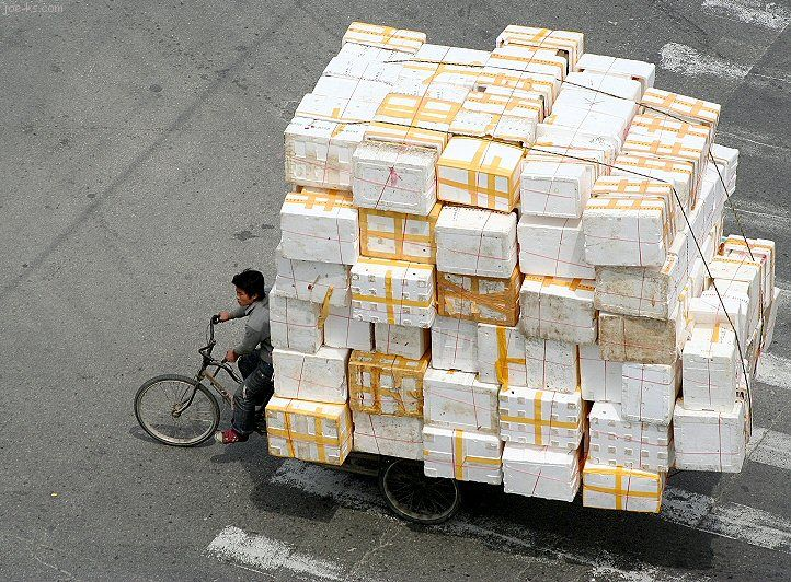 enormous bike load. Even if these are empty syrofoam boxes, it's still impressive.
