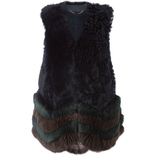 FENDI Shearling Vest with Fox Fur and Leather ($8,600) ❤ liked on Polyvore featuring outerwear, vests, fendi, genuine leather vest, sheep fur vest, leather shearling vest and leather waistcoat