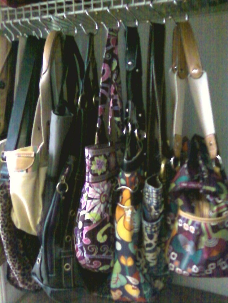 Shower curtain hooks to hang purses in closet.