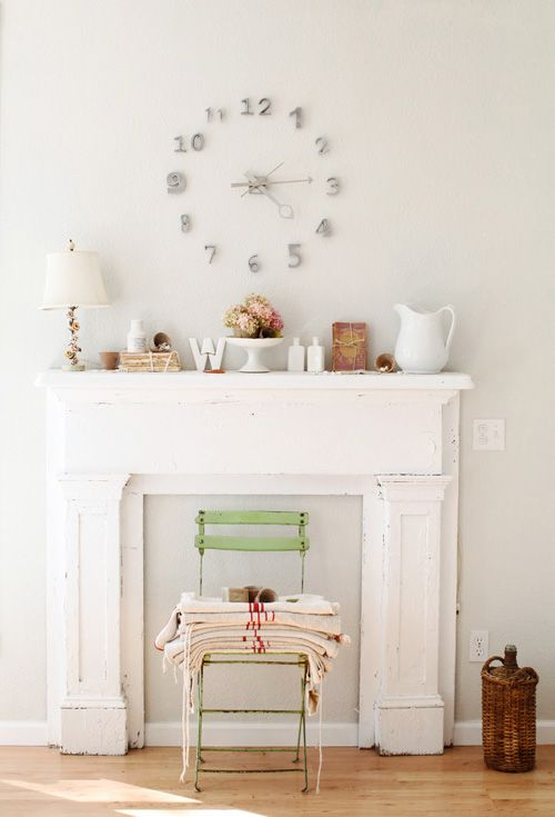 I would love a faux fireplace just to have a mantle like this.