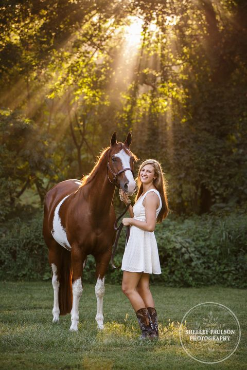 A popular outfit for senior photos with your horse - ivory dress with cute boots.