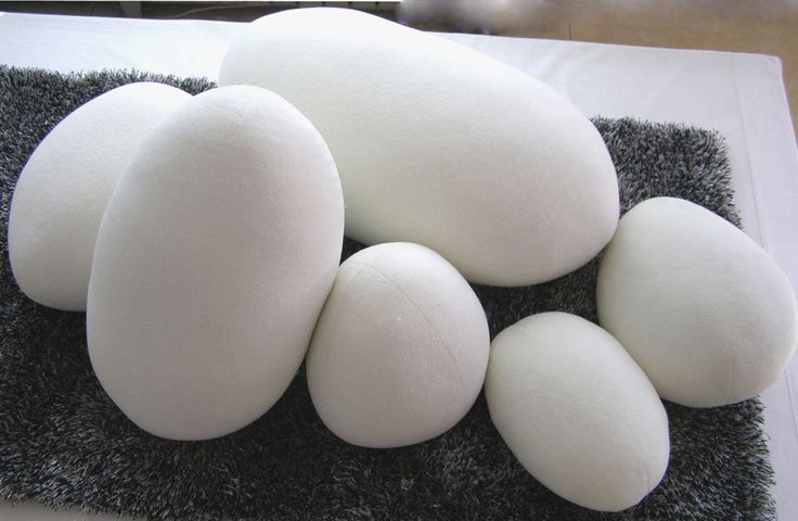 White Pebble Pillows Design ~ http://www.lookmyhomes.com/unique-view-and-functional-pebble-pillows/
