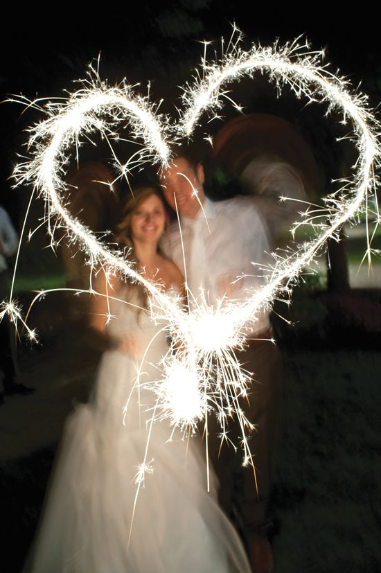 Sweet sparkler wedding photo. Photo courtesty of Capturing the Light.