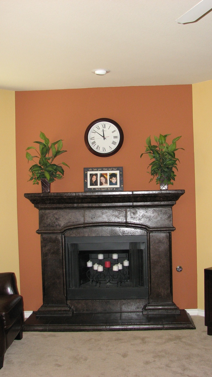 white stone fireplace finished with metallic oil rubbed bronze