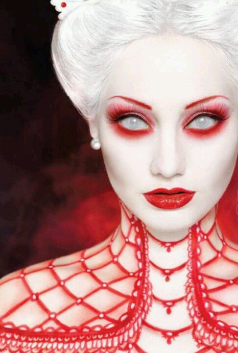 just simply powdering your face and adding red around your eyes can spook up any costume!