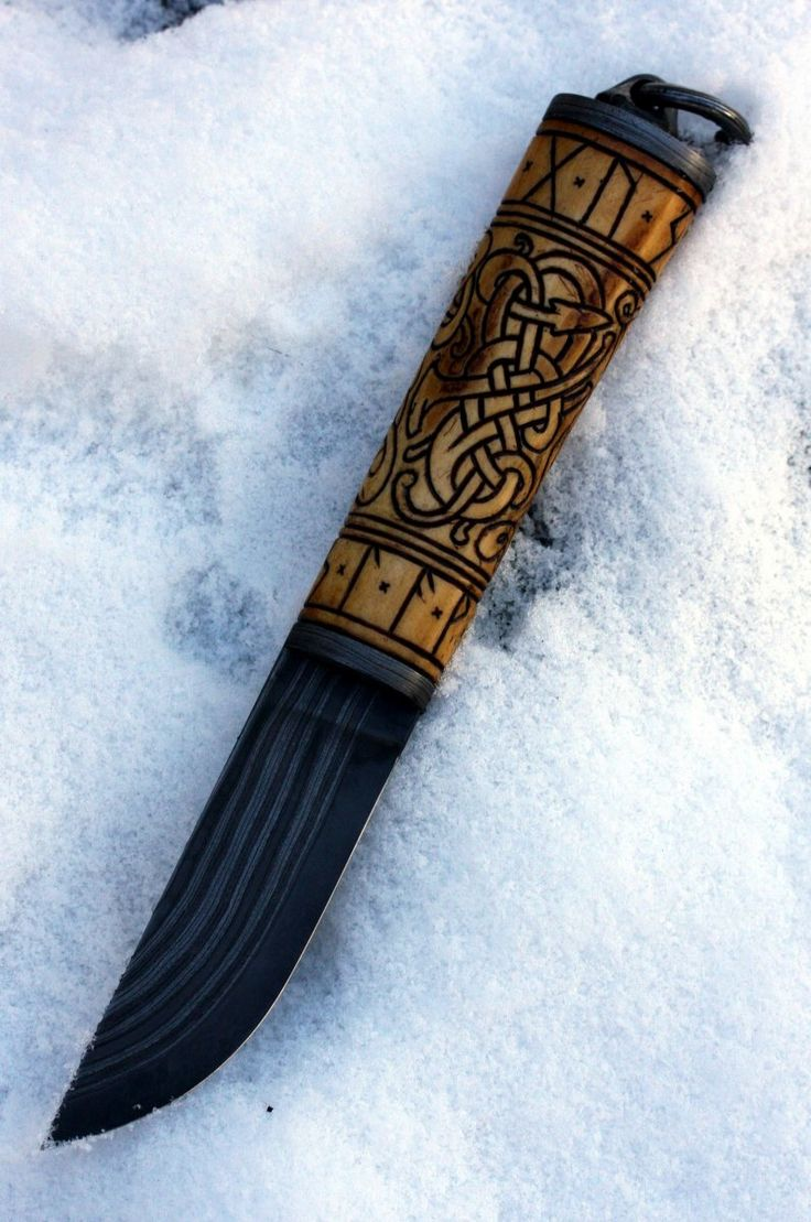 Scandi ground puukko with carved ostrich bone handle in norse Urnes style made by Petr Melicharek.