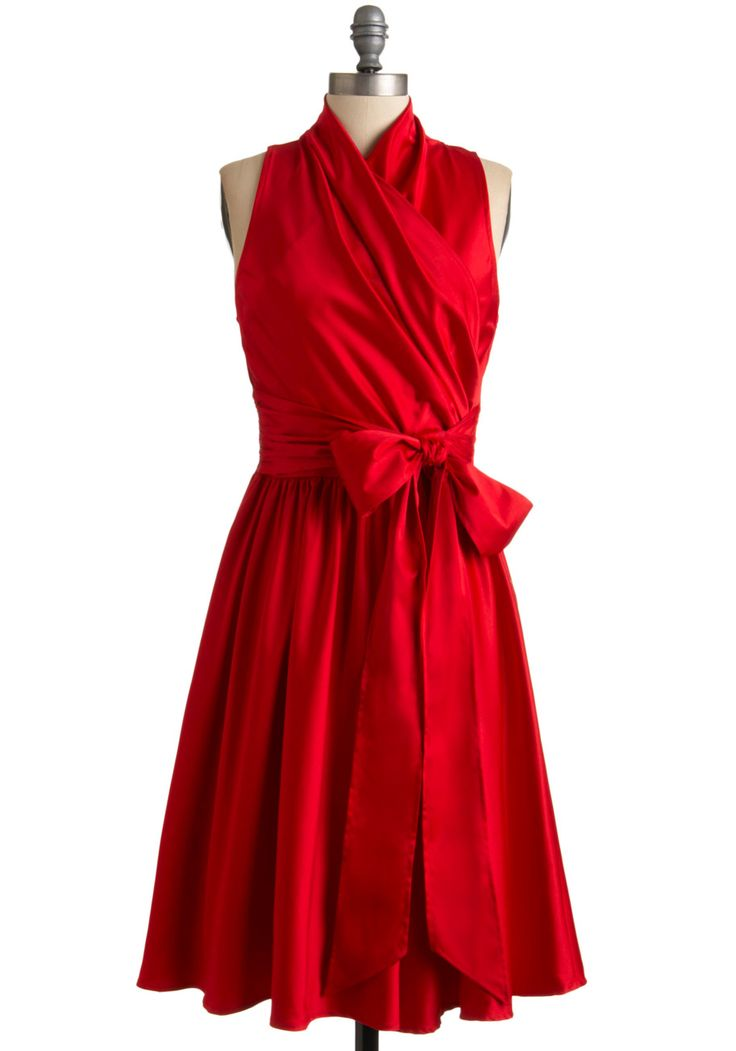 This dress is beyond stunning -- and I thought there was no such thing as a modest wrap front dress!