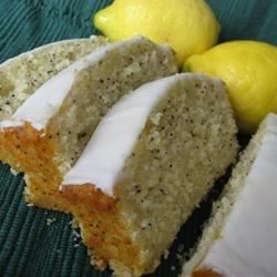 Lemon extract provides the flavor point in this citrus loaf, gilded with a sweetened orange juice sauce.