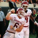 The door to the playoff's top four has been kicked open after No. 1 Georgia and No. 3 Notre Dame were blown out. No. 2 Alabama survived Mississippi State's upset bid and Oklahoma QB Baker Mayfield took another step toward securing the Heisman Trophy.