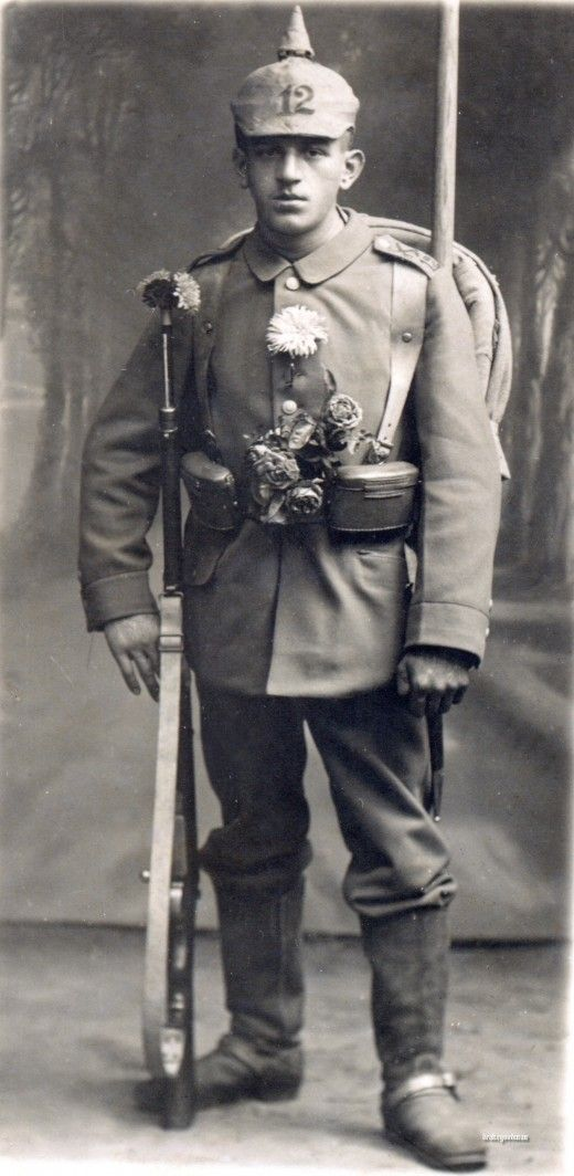 WWI German soldier with flowers.