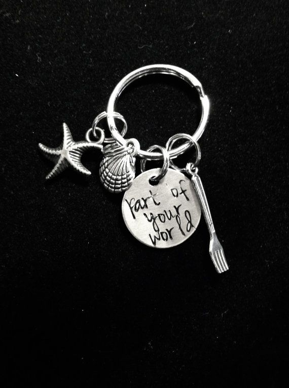 Inspired by The Little Mermaid, this is a perfect addition to your keychain. A silver 11/16 (about the size of a penny) charm is engraved with the