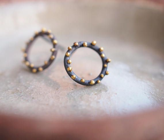 This organic textured circle studded stud earrings is handcrafted with oxidized sterling silver and 22k yellow gold. Its a perfect earrings for a design lover. The diameter of the circles are approximately 10mm. Please contact me for any questions. Thank you for looking :) 8% of