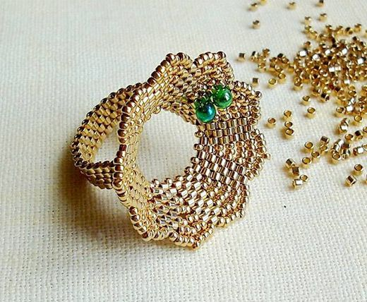 Flower ring, free tutorial. I think it calls for a  Rivoli in the center.