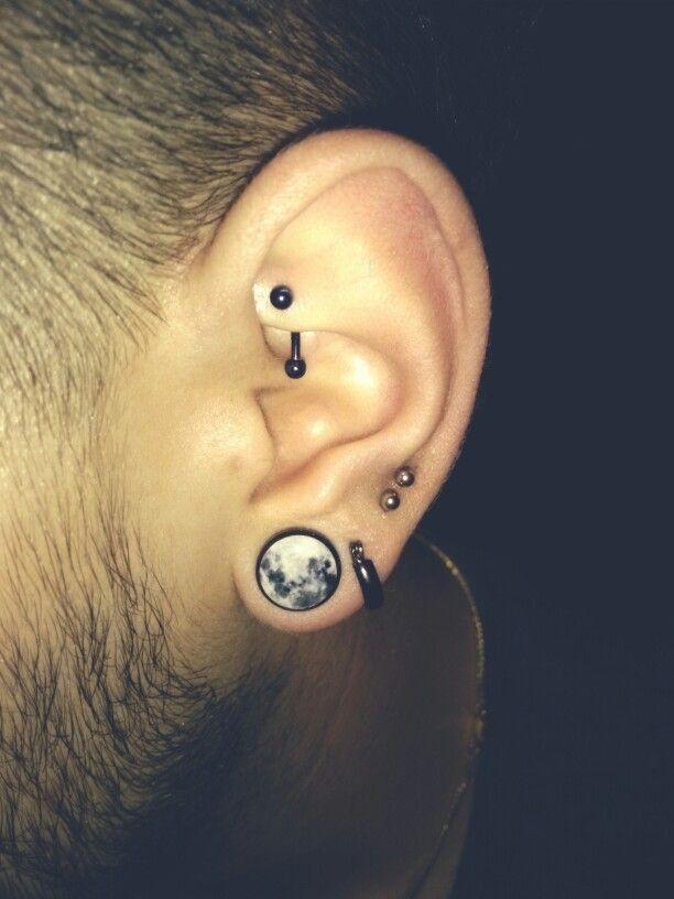 My rook | double lower cartilage piercing | moon 1/2 gauge plugs.  Love it