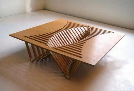 Smart design. This table is made of one plate. See article.